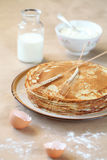 Blini - traditional Russian pancakes. On beige plate, on light beige background royalty free stock photography
