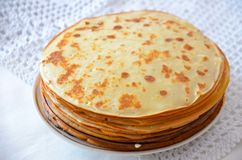 Blinis. Or crepes in a stack isolated on white background royalty free stock photo