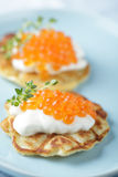 Blinis with red caviar Royalty Free Stock Images