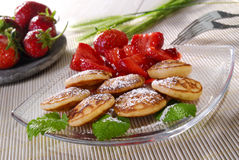 Blinis with strawberries. Pancake  on a plate with fresh strawberries Royalty Free Stock Images