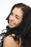 Blink at the camera. Lateral head and-shoulder recording of a young black-haired woman against white background, look over the shoulder and the camera give a stock images