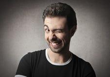 Blink. Man blinking with his left eye stock image