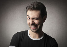 Blink. Man blinking with his left eye royalty free stock images