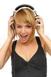 blinka för musik för flicka lyssnande Arkivbilder