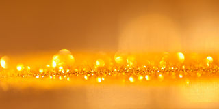 Blinkad guldbakgrund - jul Arkivfoton