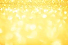 Blinkade abstrakt jul för guld ljus bakgrund Royaltyfri Foto