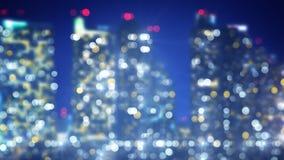 Blinkande ljus av bakgrund för nattstadssuddighet Royaltyfri Bild