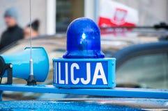 Blinkande ljus på den Milicja bilen Milicja är det gamla namnet för polisen i Polen royaltyfria foton
