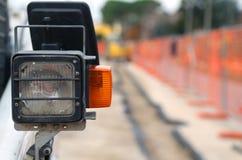 Blinker einer Planierraupe im Straßenbaustandort Lizenzfreie Stockfotografie