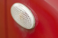 Blinker. A white blinkar on a red car Stock Images