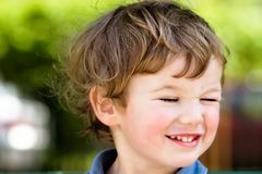 Blinking boy Royalty Free Stock Photo
