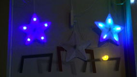 Blinking Christmas star decorations on house wall stock video