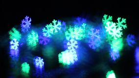 Blinking Color Lights snowflake bokeh stock footage