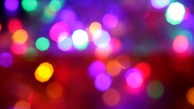 Blinking colorful garlands blurred effect, full frame. Multicolored blinking Christmas garland, full frame stock footage