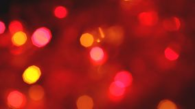 Blinking colorful garlands blurred effect, full frame. Use as background stock footage