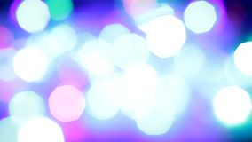 Blinking colorful garlands, blurred effect. Used as background stock footage