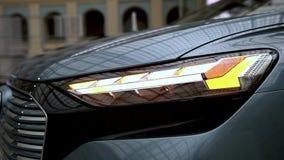 Blinking headlight car turn close up. Car of the future, luxury business. Blinking headlight car turn close up. Car of the future, luxury business stock footage