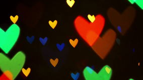 Blinking hearts. Colorful defocused blinking heart bokeh festive lights as abstract background. 1920x1080 full hd footage stock video footage