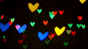 Blinking hearts. Colorful defocused blinking heart bokeh festive lights as abstract background. 1920x1080 full hd footage stock video