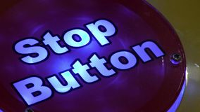 Blinking red stop button stock footage