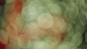 Blinking Round Defocused Lights. Blinking And Moving In White, Orange, Red And Green stock footage