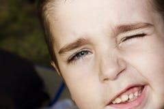 Blinks eye handsome boy royalty free stock photo