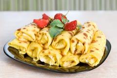 Blintzes (cheese pancakes). With fresh strawberry Stock Photo