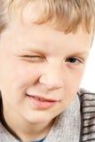 Blinzeln des Jungen Stockbilder