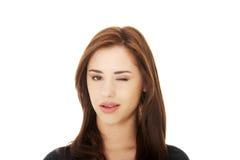 Blinzelnauge der jungen Frau Lizenzfreie Stockbilder