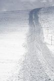 blisko groomer ślad na śniegu obraz royalty free
