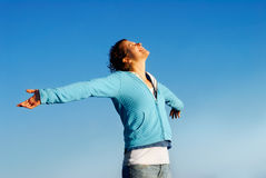 Bliss. Happy young woman lifting her face to the sky stock image