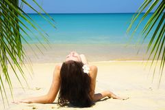 Bliss. View of a nice young female in tropical environment royalty free stock images