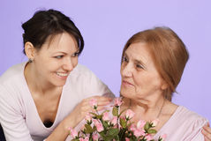Bliss Caucasian elderly woman and her daughter Stock Photos
