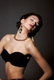 Bliss. Sultry Graceful Beauty in Black Bra with Golden Jewelery - Necklace and Earrings Royalty Free Stock Images