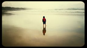 Bliss. Young boy on beach  reflection Royalty Free Stock Photos