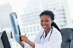 Blissful female doctor looking at a set of X-rays Stock Photo
