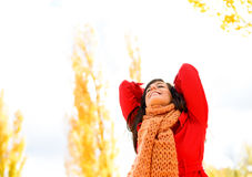 Blissful and joyful woman in autumn. Blissful beautiful woman enjoying autumn season outdoors. Happy caucasian brunette bliss and satisfaction in fall. Autumnal Royalty Free Stock Image