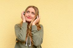 Blissful pretty blond woman listening to music stock photo