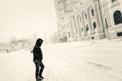 Blissful solitude. Person on the pedestrian crossing in the center of Bârlad during winter Royalty Free Stock Images