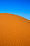 Blissful view of sand dunes. And cloudless sky, Erg Chebbi, Morocco Royalty Free Stock Photos