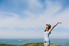 Blissful woman enjoying coast vacation travel Royalty Free Stock Image