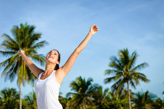 Blissful woman enjoying tropical caribbean vacation. Joyful and blissful woman enjoying caribbean travel to Mayan Riviera, Mexico. Brunette caucasian girl on Royalty Free Stock Image