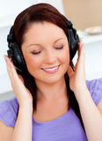 Blissful woman listening to music Stock Photo