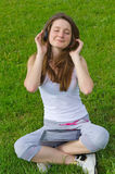 Blissful woman listening to music Stock Photos