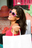 Blissful woman shopping in the sales. Blissful woman holding white shopping bags and enjoying the commercial store sales. Happy caucasian fashion brunette after Stock Images
