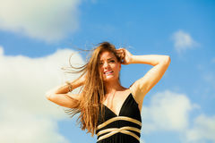 Blissful woman vacation day. Happy smiling crazy tourist on beach outdoor Royalty Free Stock Photo