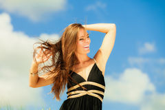Blissful woman vacation day. Happy smiling tourist on beach outdoor Royalty Free Stock Photo