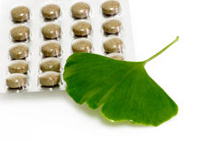 Blister. Ginkgo biloba leaf with pills on bright background Royalty Free Stock Photography