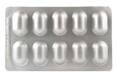 Blister di alluminio su fondo bianco Fotografia Stock