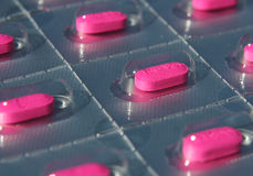 Blister pack of pink pills Stock Photos